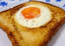 Egg in a hole. This is a simple and quick recipe very easy to make at your home. It is a good idea for preparing as breakfast or as appetizer.